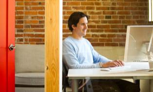 SilkStart CEO Shaun Jamieson working at his desk
